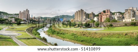 Panoramic cityscape of park with river and buildings in Taipei, Taiwan. - stock photo