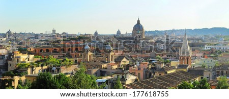 Panoramic colorful view of Rome at sunset. Italy - stock photo