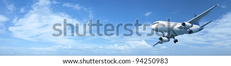 Panoramic composition of a jet aircraft in a blue sky - stock photo