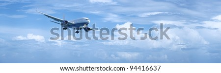 Panoramic composition of a jet plane in a cloudy sky in high resolution - stock photo