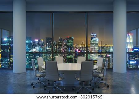Panoramic conference room in modern office, cityscape of Singapore skyscrapers at night. White chairs and a white round table. 3D rendering. - stock photo