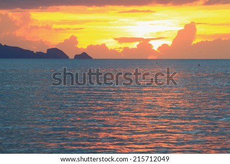 Panoramic dramatic golden sunset sky and tropical sea at dusk