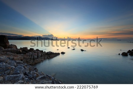 Panoramic dramatic sunset sky and tropical sea at dusk  - stock photo