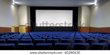 Panoramic empty cinema auditorium. - stock photo