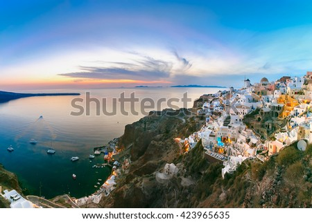 Panoramic famous view, Old Town of Oia or Ia on the island Santorini, white houses and windmills at sunset, Greece - stock photo
