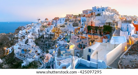 Panoramic famous view, Old Town of Oia or Ia on the island Santorini, white houses and windmills at dawn, Greece - stock photo