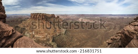 Panoramic from Grandview Point Overlook on the edge of a deep canyon in Canyonlands  National Park near Moab Utah. - stock photo