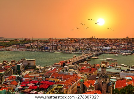 Panoramic Golden Horn sunset view with Blue Mosque and Hagia Sophia from Galata tower, Istanbul, Turkey - stock photo