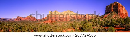 Panoramic image of Courthouse Butte and surrounding mountains in Sedona, Arizona