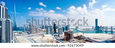 Panoramic image of Dubai city,  modern cityscape, downtown with blue sky, luxury new high-tech city at Middle East, United Arab Emirates - stock photo