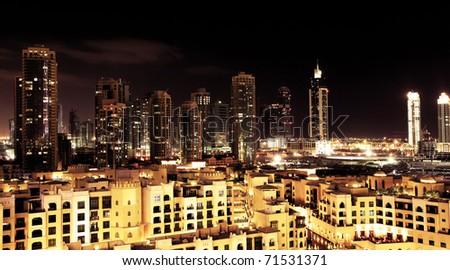 Panoramic image of Dubai downtown at night - stock photo