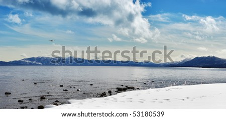 Panoramic image of Lake Tahoe in winter. - stock photo