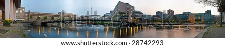 Panoramic image of modern architecture around public buildings, offices and residential apartments, just before dusk - stock photo