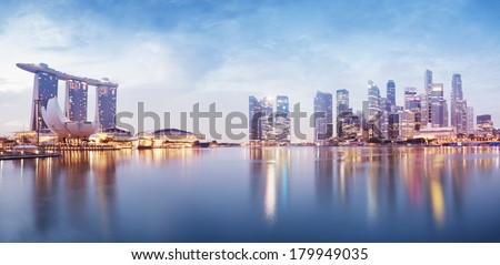 Panoramic image of Singapore`s skyline at night. - stock photo
