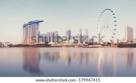 Panoramic image of Singapore`s skyline at sunrise. (stiched from several images :Panoramic) - stock photo