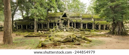 Panoramic image of the derelict north entrance of Ta Prohm temple, Angkor Wat, Cambodia - stock photo