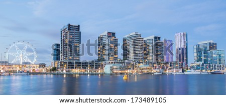 Panoramic image of the Docklands waterfront at night in Melbourne, Australia - stock photo