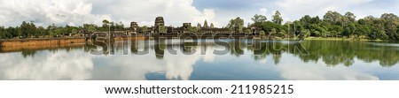 Panoramic image of the moat and causeway at Angkor Wat Temple, Cambodia - stock photo