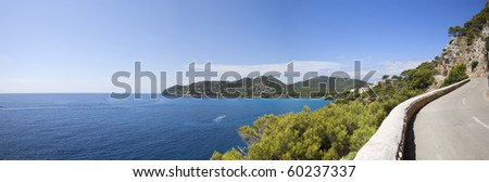 panoramic image of the summer road and wide view of the sea
