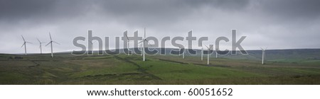 panoramic image of wind farm - stock photo
