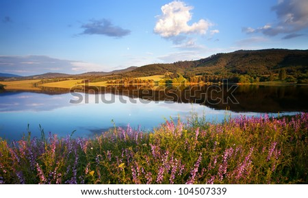 panoramic lake view in summer sunset time - stock photo