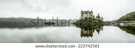 Panoramic Landscape Chateau de Val in a foggy morning, in Auvergne, France - stock photo