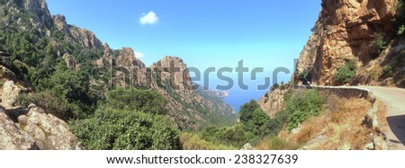 Panoramic landscape of a road along the coast of Corsica - stock photo