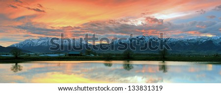 Panoramic landscape of a sunset sky in the Wasatch Mountains, Utah, USA. - stock photo