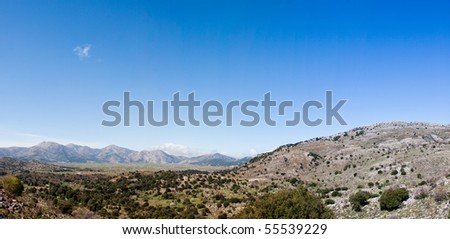 Panoramic landscape of Lasithi Plateau in spring in Crete island, Greece - stock photo