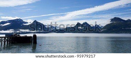 Panoramic landscape of Pier in Valdez Harbor with mountain - stock photo