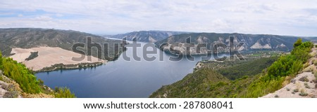 Panoramic landscape of the Ebro River passing through mountains, Aragon Spain. - stock photo