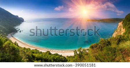 Panoramic landscape of the rocky coastline sea and Jaz Beach at sunshine. Budva, Montenegro. Adriatica. Top view. - stock photo