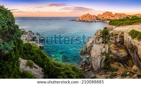 Panoramic landscape sunset view at rocky ocean coastline, Capo Testa, Sardinia, Italy - stock photo