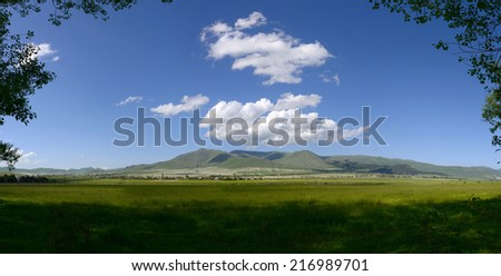 Panoramic landscape with heavenly clouds  - stock photo