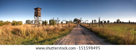 panoramic landscape with raised hide - stock photo