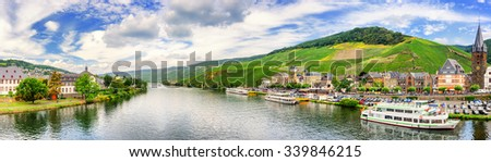 Panoramic landscape with vineyards surrounding the town of Bernkastel-Kues. Mosel, Germany - stock photo