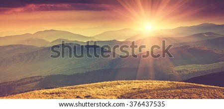 Panoramic mountain landscape in spring with sunlight. Filtered image:cross processed vintage effect. - stock photo