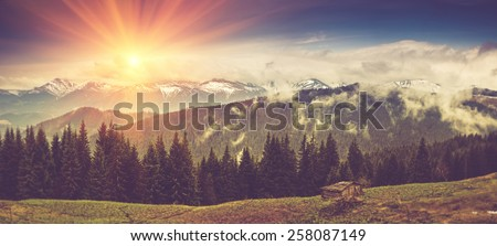 Panoramic mountain landscape in spring with sunlight. View of the old farm. Filtered image:cross processed vintage effect. - stock photo