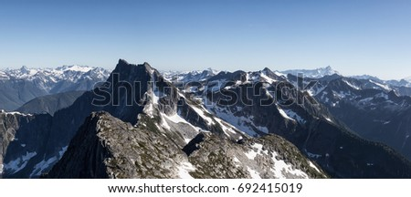 Panoramic Mountain Landscape view during a summer day. Picture taken from top of Macdonald Peak near Chilliwack, East of Greater Vancouver, British Columbia, Canada. High Resolution Panorama
