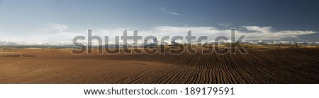 Panoramic of a freshly tilled field - stock photo