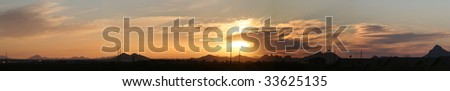 Panoramic of an Arizona sunset with power lines visible in the distance - stock photo