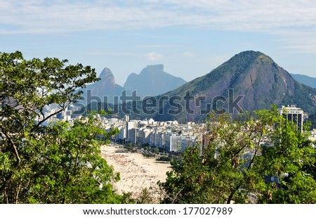 Panoramic of Copacabana - vegetation, beach, buildings, communities and beautiful mountains - the city Rio de Janeiro - stock photo
