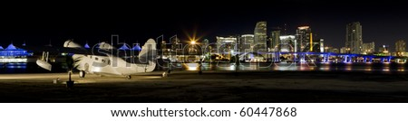 Panoramic of Downtown Miami and Biscayne Bay in the evening with a vintage seaplane in the foreground. - stock photo