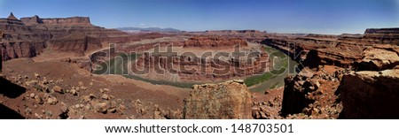 Panoramic of Gooseneck Bend on the Colorado River from Canyonlands National Park. - stock photo