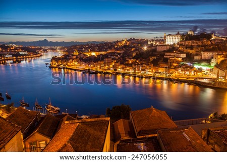 Panoramic of old Porto and Douro river at night, Portugal - stock photo