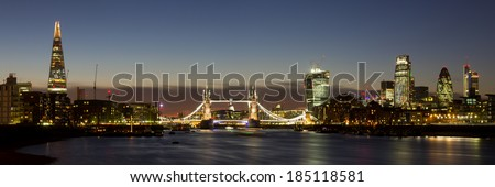 Panoramic of the City of London with Tower Bridge, The Shard, Walkie Talkie, Gherkin and other skyscrapers - stock photo