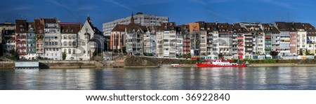 Panoramic of waterfront houses along the Rhine River in Basel, Switzerland - stock photo