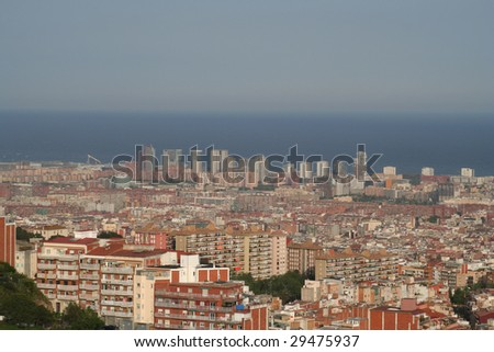 Panoramic overview of Barcelona's Urban density some high rises of the 21 aroba quarter in the background of the Mediterranean sea