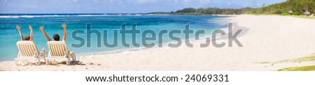 Panoramic photo of happy couple in tropical paradise - stock photo