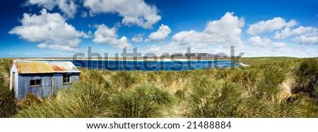 Panoramic Photo of Kidney Island Coastline on the Falkland Islands - stock photo